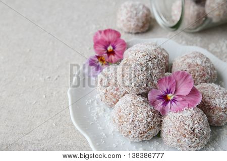 Homemade Strawberry, Date, Cashew And Coconut Bliss Ball With Edible Flowers