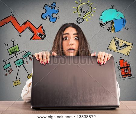 Businesswoman with a frightened expression behind the pc