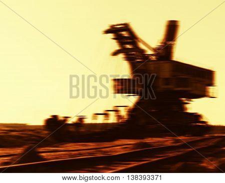 Horizontal vibrant sepia cyberpunk mining machine blurred background backdrop
