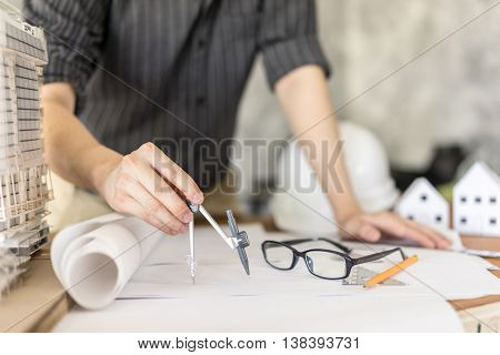 business architect drawing on blueprint architectural project