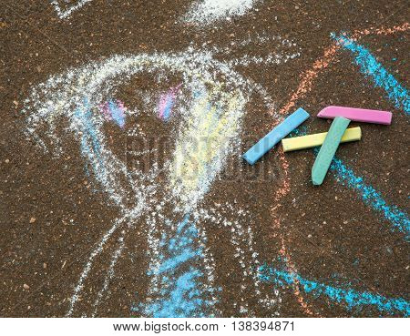 Colored chalk for drawing. Colored chalk on the playground with drawings on the street