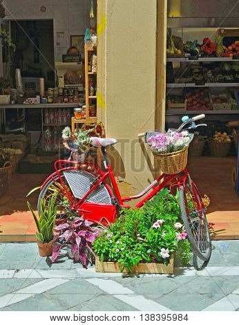 Malaga, Andalucia, Spain - June 29, 2016:  Bicycle and Flower Display outside shop in Malaga.