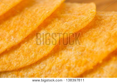 Detail of fried potato chips close up.
