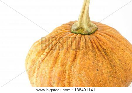 Small asian yellow pumpkin on white background. Object side view and Tilt 45 degrees