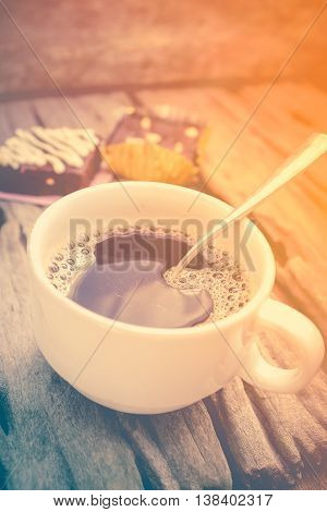 Hot Coffee And Cake Chocolate Brownie On Old Wooden Background. Retro Style.