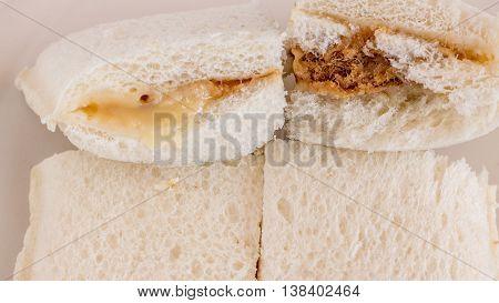 Sandwich ,bread ,mayonnaise, shredded pork filling.Eat bread,Shredded Pork Sandwich