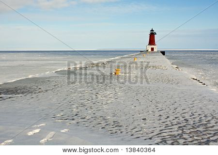 Lighthouse On Frozen Pier