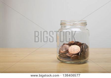 British Coins In A Glass Jar