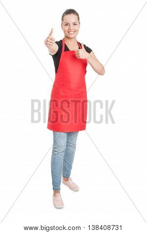 Joyful Young Saleswoman On Supermarket Showing Double Thumbup