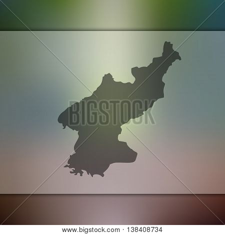 North Korea map on blurred background. Blurred background with silhouette of North Korea. North Korea. North Korea map.