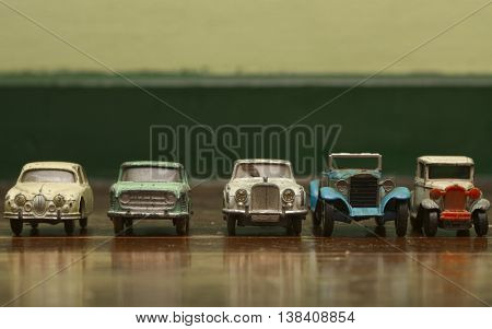 old tin toy car on old wooden floor