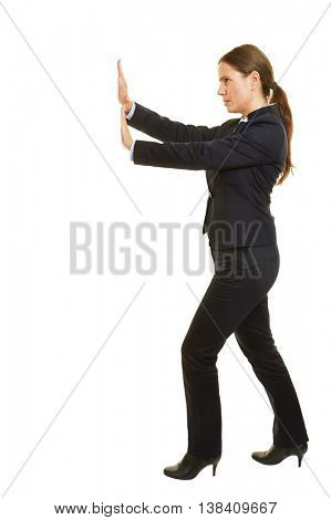 Isolated full body business woman pushing boundary to the side