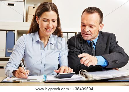 Financing audit in company with accountant and manager in the office