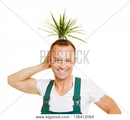 Happy gardener holding a plant behind his head as a funny hair style