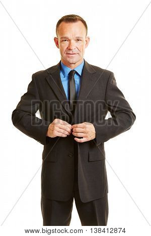 Business man buttoning up his suit buttons with his fingers