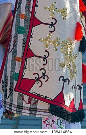 Detail of Serbian folk costume for woman with multi colored embroidery.