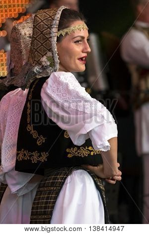 ROMANIA TIMISOARA - JULY 7 2016: Young Romanian dancer in traditional costume perform folk dance during