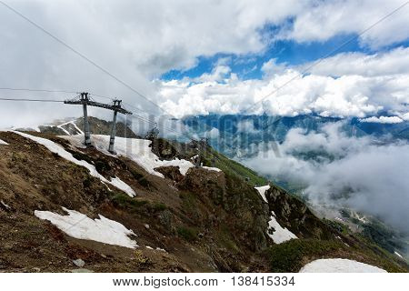 Cableway Gondola in the mountains on a cloudy summer day