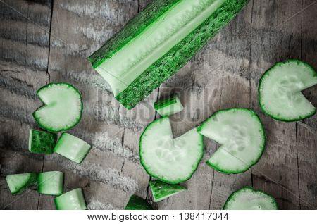 Cucumber on a wooden board. Tomatoes and cucumbers. Vegetables on a wooden table. Green.