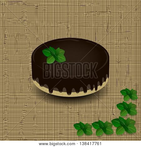 sponge cake with chocolate icing drizzled with a sprig of mint on the texture background