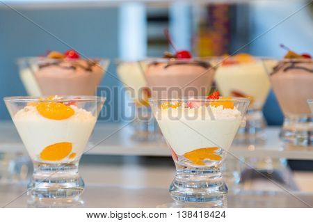 Peach and Chocolate Puddings in Glasses on display
