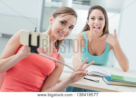 Beautiful Girls Using A Selfie Stick