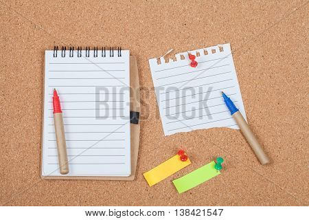 book note and paper note on cork board