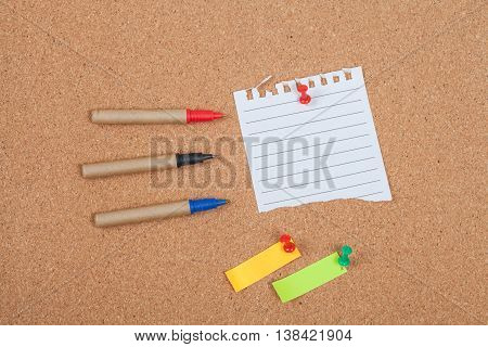 pin on memo paper on cork board
