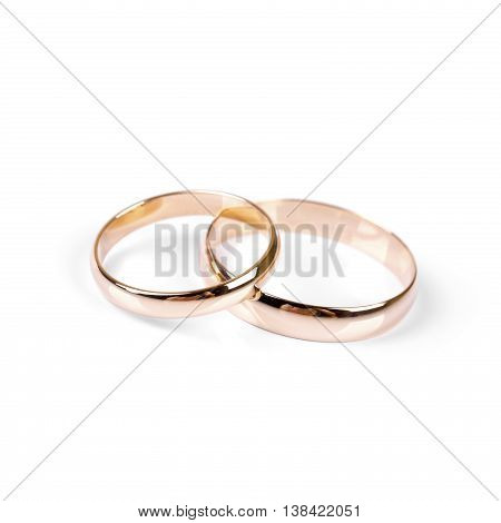classic golden wedding rings isolated on white