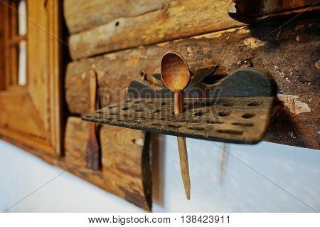 Old wooden spoon on a stand retro