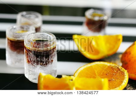 jagermeister alcoholic cocktail drinks on a board with orange