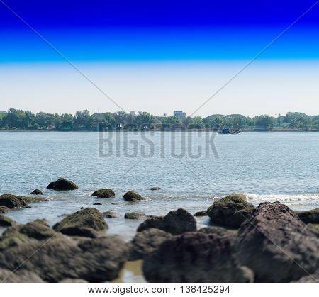 Horizontal Dramatic Indian Stony Beach Bokeh Landscape Backgroun