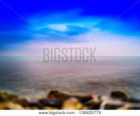Horizontal vivid Norway stony ocean beach abstraction background backdrop
