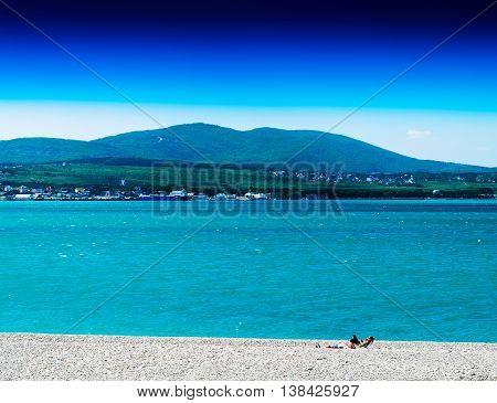 Horizontal Vivid Stony Beach With Big Hill Landscape Background