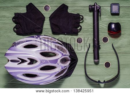 Items replacements and tools for a safe cycling: Helmet gloves glasses pump patches. Tools and accessories set for cycling flat lay.