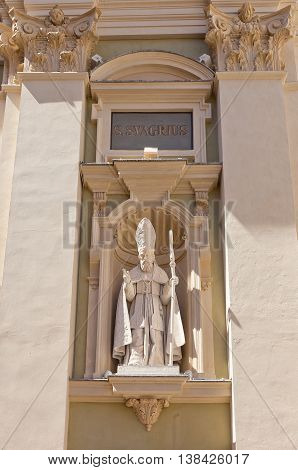 NICE FRANCE - APRIL 11 2016: Statue of St Syagrius on the facade of Cathedral of Saint Reparata (circa 1699) in Nice France. St Syagrius (died 600 AD) was a bishop of Autun