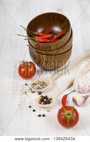 Vegetables and spices in wooden bowls ,