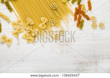 Raw Pasta And Spices On Wooden Background
