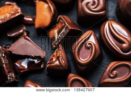 Chocolate Candy Sweets  in high resolution. Dark chocolate stack chips and powder. Set of candies collection.