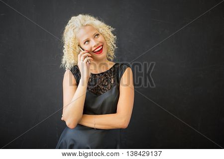 Woman talking on the phone and smiling