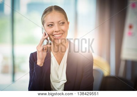 Businesswoman talking on mobile phone in the office
