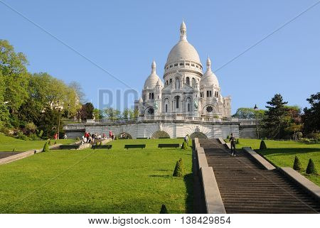 Paris, France - June 05, 2008: Gardens and stairs to the Basilica of the Sacred Heart in Montmartre
