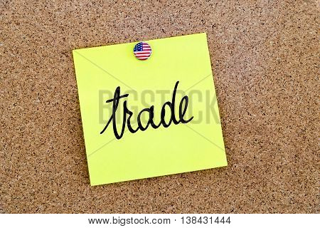 Written Text Trade Over Yellow Paper Note