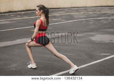 Sporty girl warming up before a competition