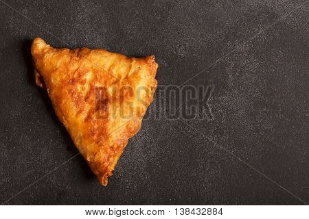 Deep fried indian dish samosa. It could be prepared with meat or vegetables