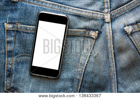 Mobile phone with blank screen for copy space, on back pocket faded jeans