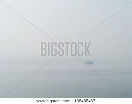 Horizontal sparse pale lonely ship in white ocean background backdrop