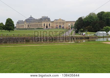 CHANTILLY, FRANCE - MAY 14, 2015: This building is called the Great Stable it is unique in the world Horses Museum.