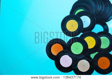 Vinyl records on blue background