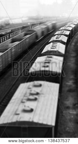 Vertical black and white toy train echelon bokeh background